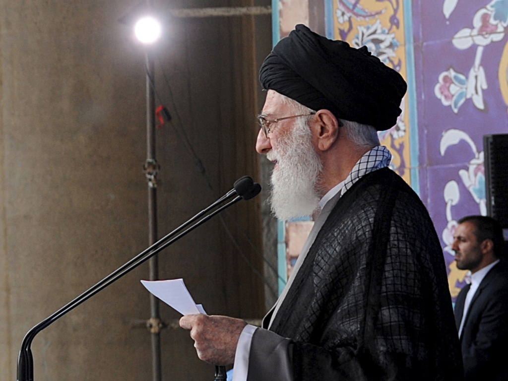 Iran's Supreme Leader Ayatollah Ali Khamenei delivers a sermon during morning prayers for the Eid al-Fitr holiday, marking the end of the holy month of Ramadan. He signaled his approval of the nuclear agreement with Western powers but reiterated that Tehran's policy toward the