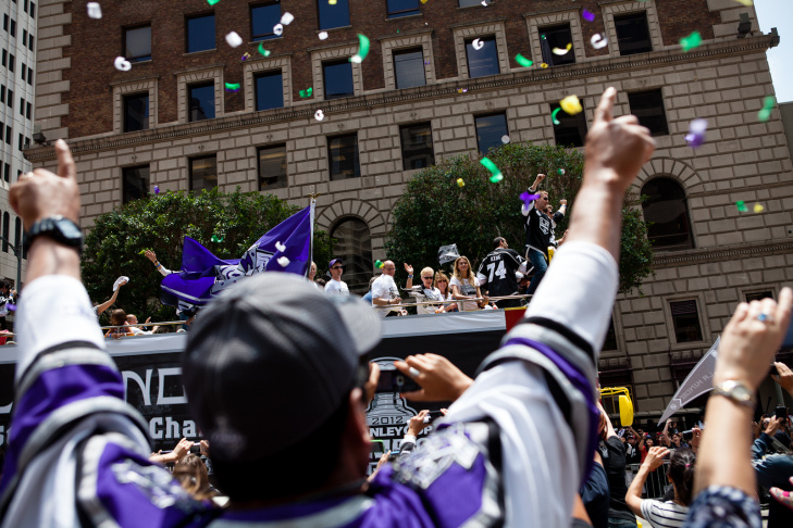 While waiting for the LA Kings parade to start, fans break into song for a TV News crew.