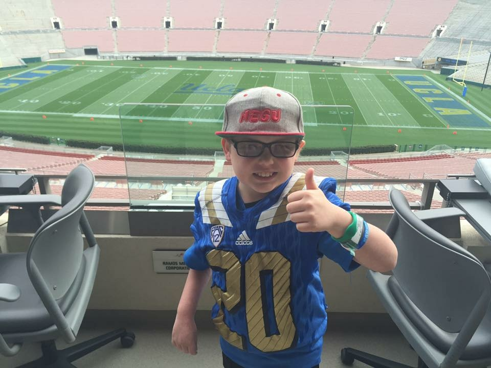 UCLA football signed Cade Spinello to its team Saturday. The 9-year-old has battled a brain tumor, massive stroke and is legally blind.
