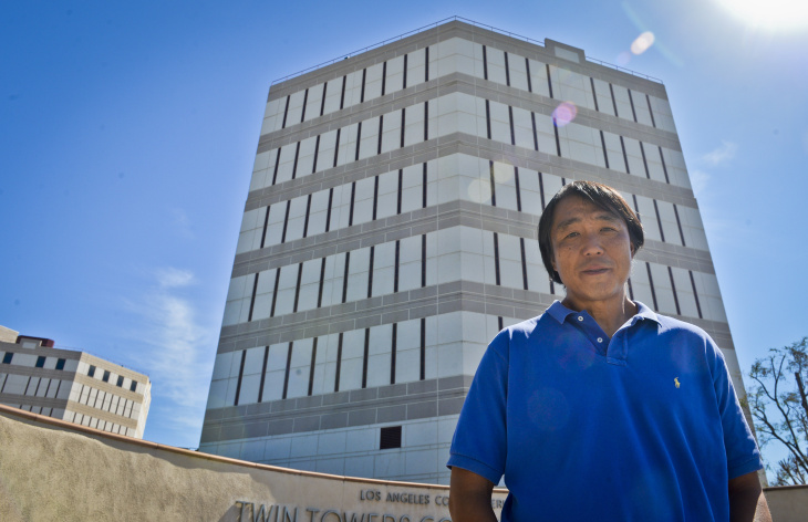 Phillip Cho stands outisde the tower where he was incarcerated at the LASD Twin Towers Correctional Facility. Cho wrote a book about his experience in jail titled