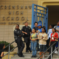 Students and police watch teachers, pare