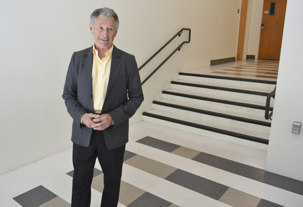 Professor Leonard Kleinrock stands by the binary tiles Boelter Hall, where he and his team sent the first Internet message in 1969.