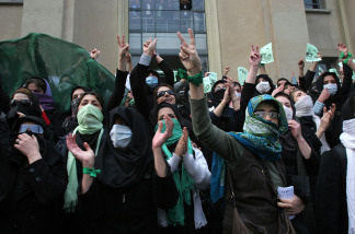 Iranian opposition supporters demonstrate at Tehran University in the Iranian capital on December 7, 2009.