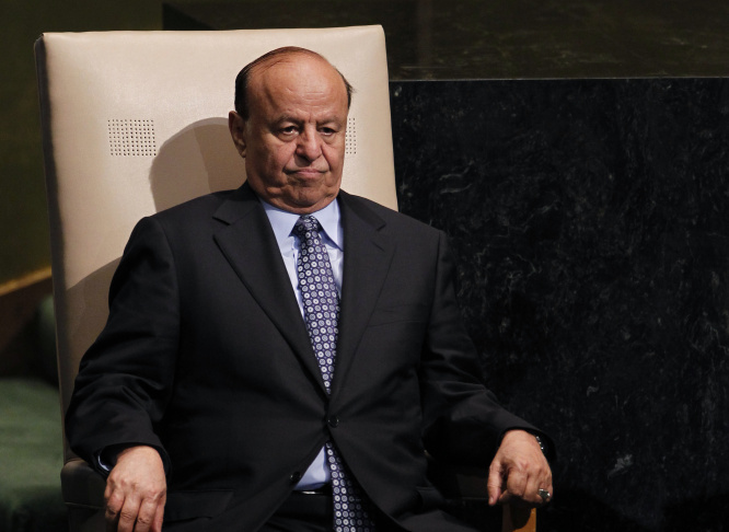 In this Wednesday, Sept. 26, 2012 file photo, Abed Rabbo Mansour Hadi, President of Yemen, sits after addressing the 67th session of the United Nations General Assembly at U.N. headquarters. A late-night deal reached with Shiite rebels who had stormed the presidential palace still leaves unanswered who really controls the country and how much power is still held by Hadi, a key ally in U.S. efforts to battle Yemen's local al-Qaida branch.