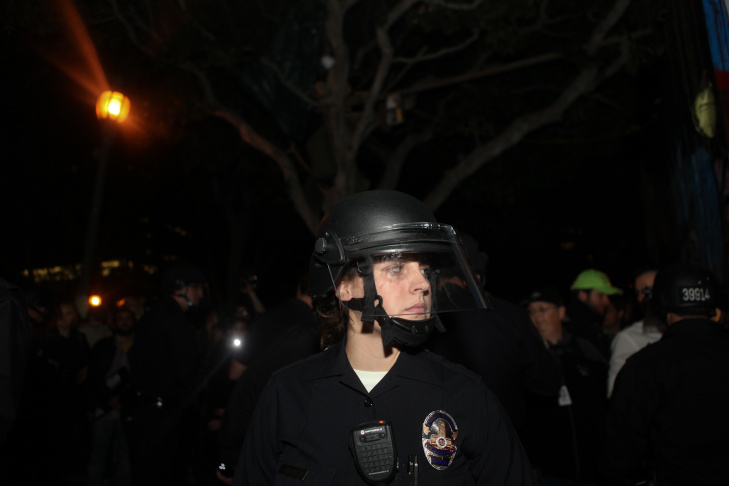 An LAPD officer threatened a demonstrator as police swarmed the plaza and encircled the protesters.
