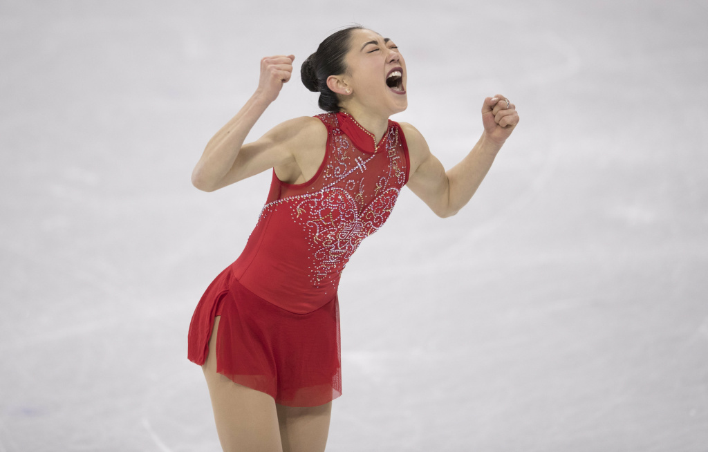 Mirai Nagasu of the United States exults after landing a triple axel during the team figure skating event at the 2018 Pyeongchang Winter Olympics.