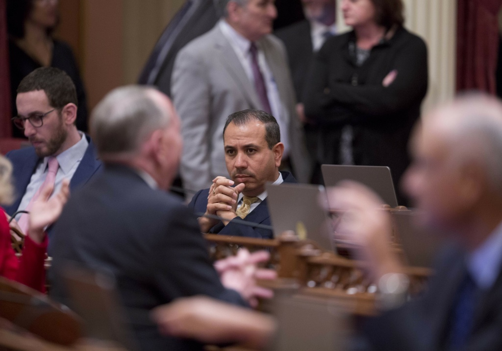 Sen. Tony Mendoza, D-Artesia, sits at his desk before announcing that he will take a month-long leave of absence while an investigation into sexual misconduct allegations against him are completed during the opening day of the Senate in Sacramento, Calif., Wednesday, Jan. 3, 2018. (AP Photo/Steve Yeater)