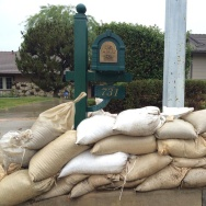 Sandbags and K rails line Rainbow Drive in Glendora in preparation for anticipated flooding.