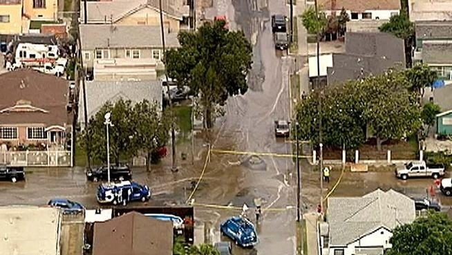 A water main break flooded the intersection at W. 59th Street and S. Hoover Street on Friday, May 25, 2012.