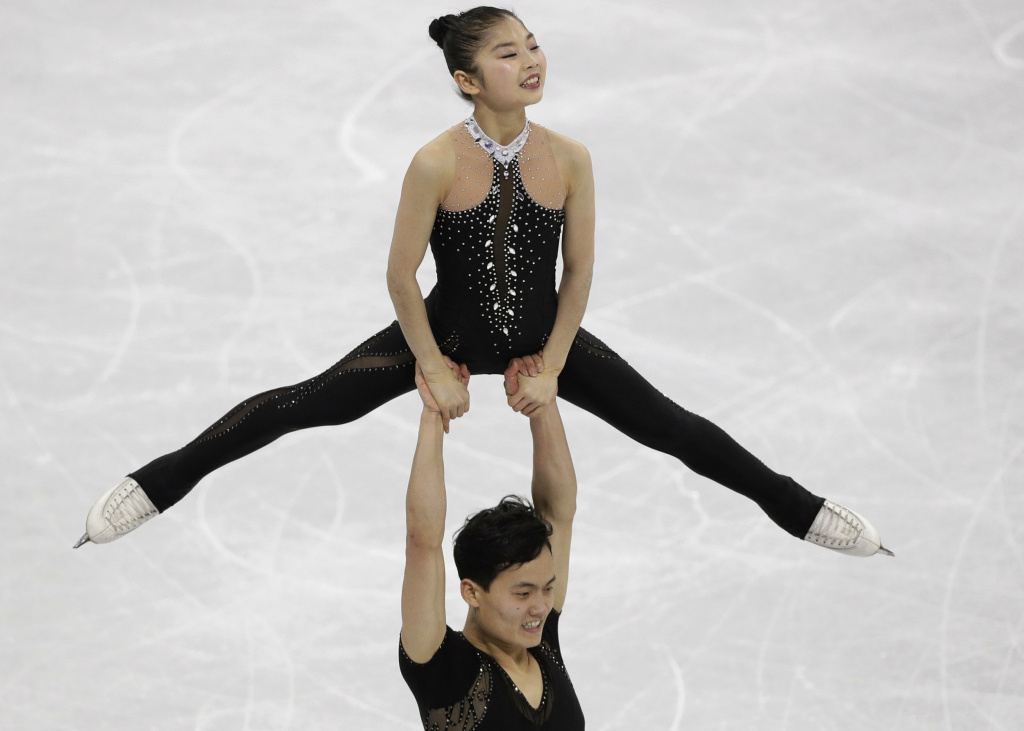 North Korea's Kim Ju Sik lifts Ryom Tae Ok during the pairs free skate final at Gangneung Ice Arena. The pair scored a personal best of 193.63 and finished 13th in their Olympic debut at the 2018 Pyeongchang Winter Olympics.