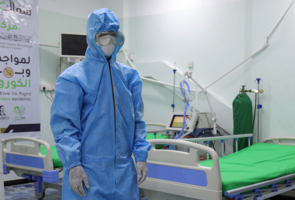 A health worker in personal protective equipment stands in a COVID-19 intensive care unit in Taiz, Yemen.