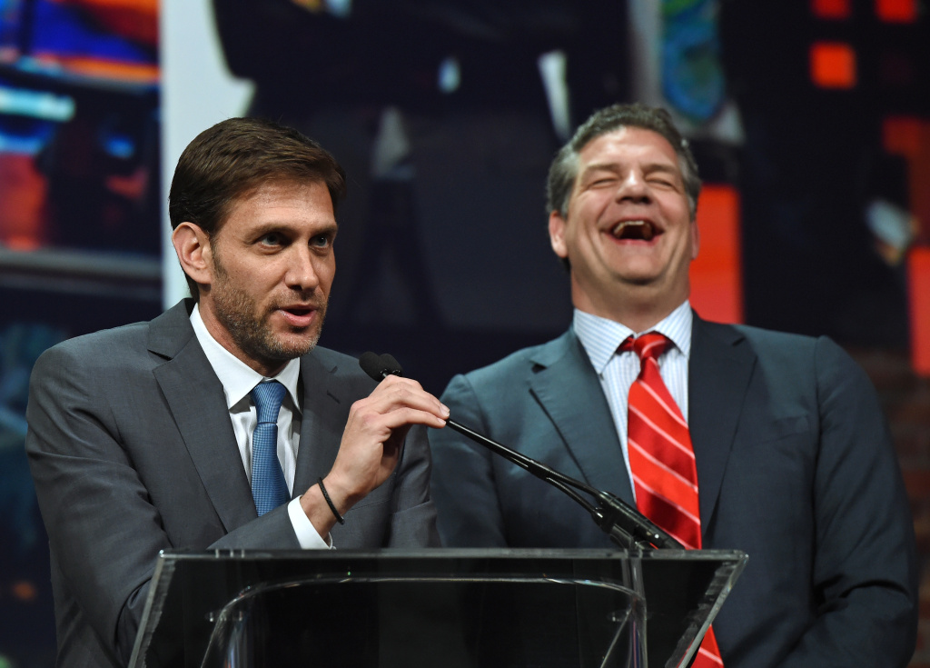 Sports broadcasters Mike Greenberg (L) and Mike Golic, hosts of ESPN Radio's