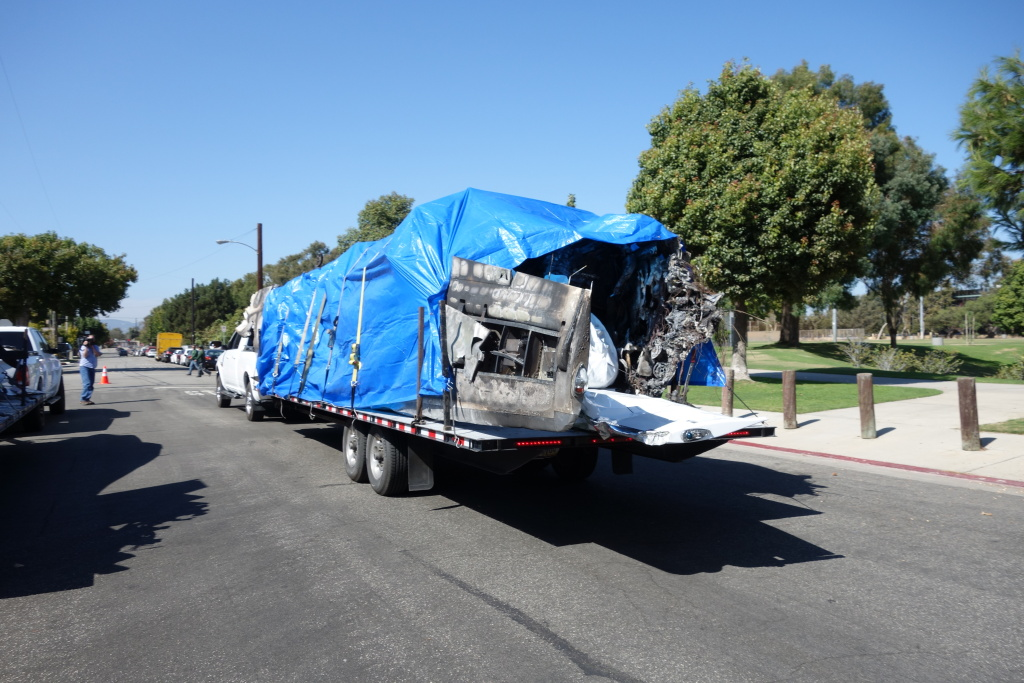 This is one of two truckloads of damaged aircraft and parts that were hauled away from Santa Monica Airport Tuesday. Santa Monica Airport Operations Administrator Stelios Makrides said the trucks contained the Cessna jet that crashed last Sunday and a prop plane that was burned when the jet hit a storage hanger at the airport.
