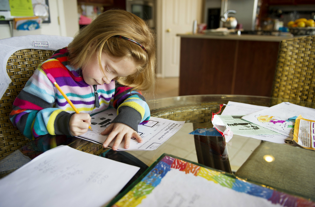 Autumn Watson does her homework in her dining room in Centreville, Maryland after class at Centreville Elementary on April 30, 2013