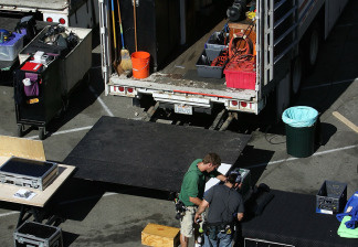 An on-location set for the filming of a movie by a major studio is filled with truckloads of equipment on November 18, 2006 in Los Angeles, California. File photo.