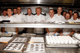 Chef Gordon Ramsay poses in the kitchen with his staff at the celebration opening party of his new Los Angeles restaurant at The London West Hollywood June 4, 2008 in West Hollywood, California