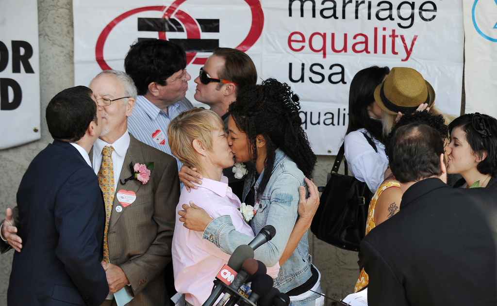 "Same-sex couples kiss at a recommitment ceremony outside the County Clerk's Office in Los Angeles on Valentine's Day, February 14, 2011. The couples requested and were rejected for marriage licenses as part of a national ""Request Marriage"" action and call for the repeal of Proposition 8 and the Defense of Marriage Act."