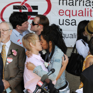 Same-sex couples kiss at a recommitment