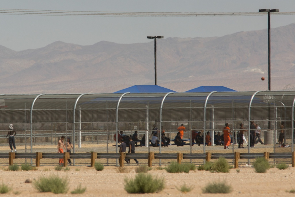 Imprisoned immigrants are seen at the US Immigration and Customs Enforcement (ICE) Adelanto Detention Facility.