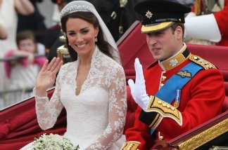 Their Royal Highnesses Prince William, Duke of Cambridge and Catherine, Duchess of Cambridge journey by carriage procession to Buckingham Palace following their marriage.