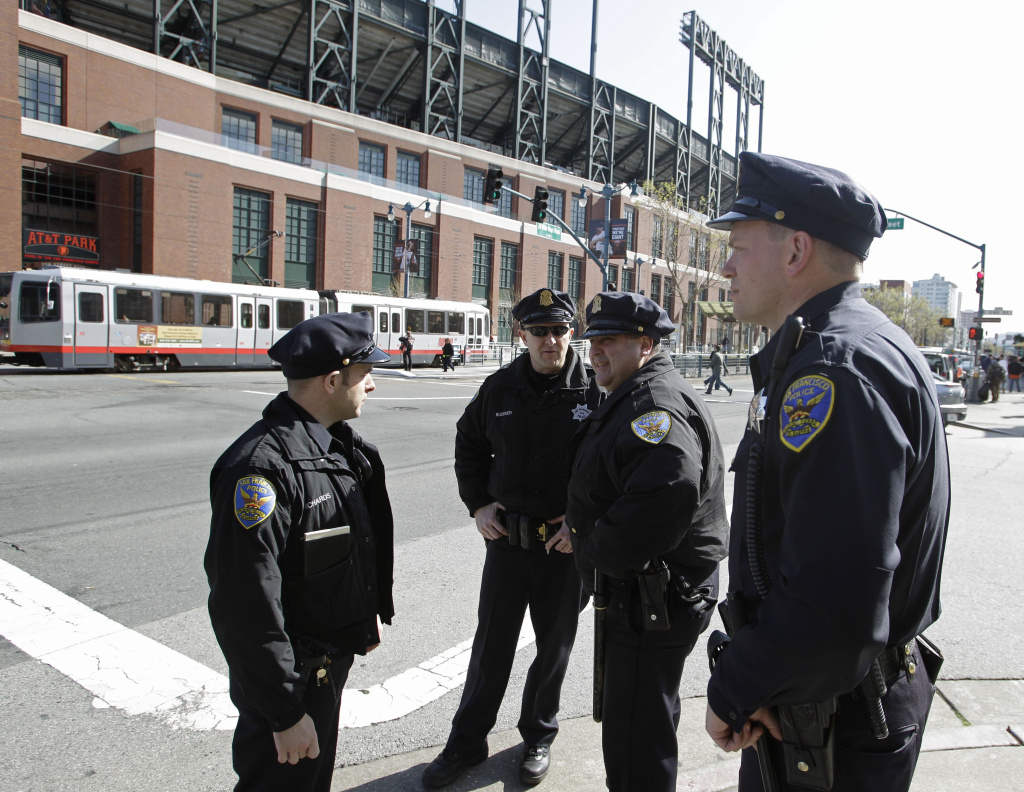 San Francisco police officers gather outside AT&T Park before the San Francisco Giants' baseball game against the Los Angeles Dodgers in San Francisco, Monday, April, 11, 2011. At the time, the Giants beefed up security for a three-game series against the Dodgers less than two weeks after a fight at Dodger Stadium left a Giants fan in a medically induced coma. This week, a man was stabbed to death after a fight broke out near San Francisco's stadium, where the Giants were playing the Dodgers.