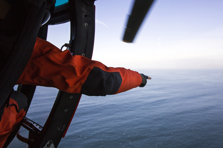 Lieutenant Mike Freeman takes part in a Coast Guard air patrol of the Los Angeles shoreline on Tuesday morning, March 15, 2016. After 50 years at LAX, the Coast Guard Air helicopters, mechanics and crewmembers are relocating to Point Mugu in Ventura County.