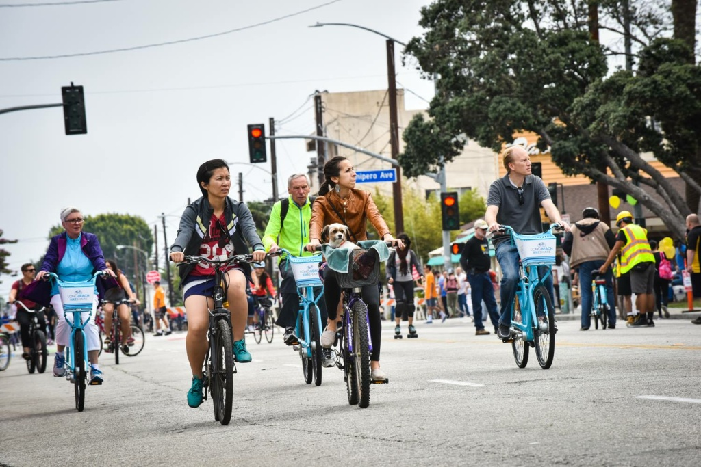 People on their bikes ride along during a Beach Streets event in Long Beach.