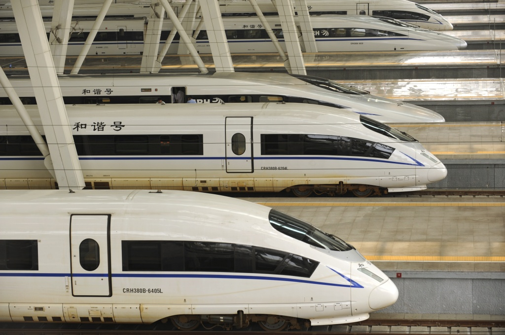 File: A picture taken on August 11, 2011 show two CRH380BL bullet trains (bottom) sitting at Beijing south railway station.
