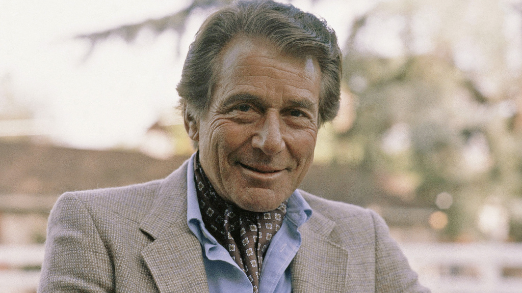 Actor Efrem Zimbalist Jr., seen here at his California home in 1982, died Friday at 95.