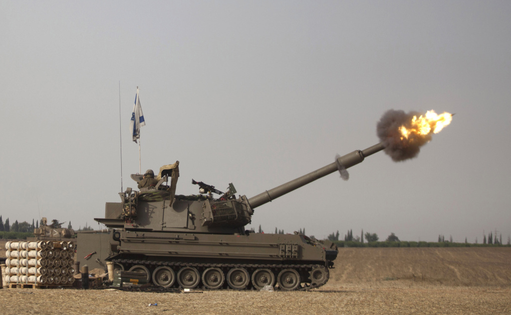 An Israeli artillery cannon fires a shell on July 12, 2014 on Israel's border with the Gaza Strip.