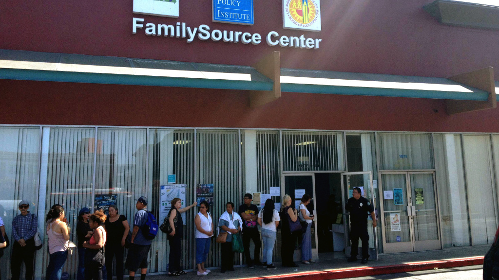 People line up at the FamilySource Center in Los Angeles, an organization in one of President Obama's five designated