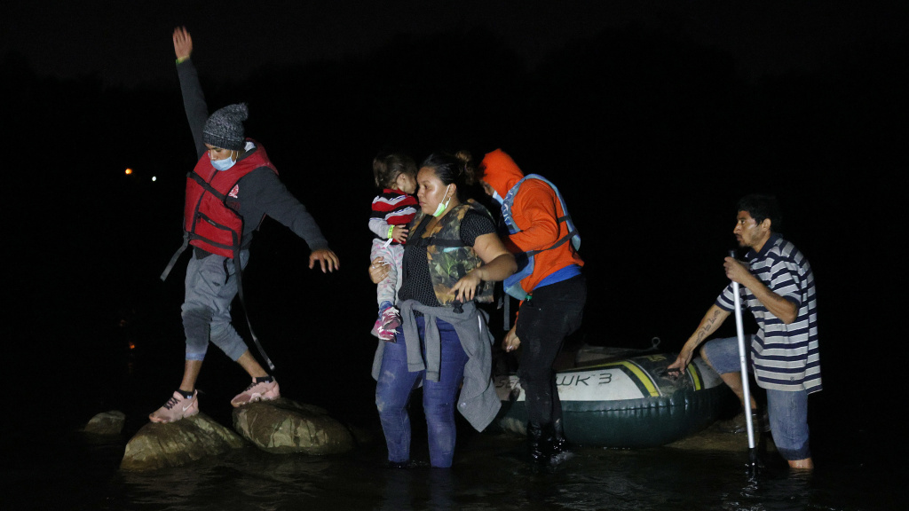A group of migrants from El Salvador arrives in Roma, Texas, after crossing the Rio Grande on March 30, 2021 in Roma, Texas.