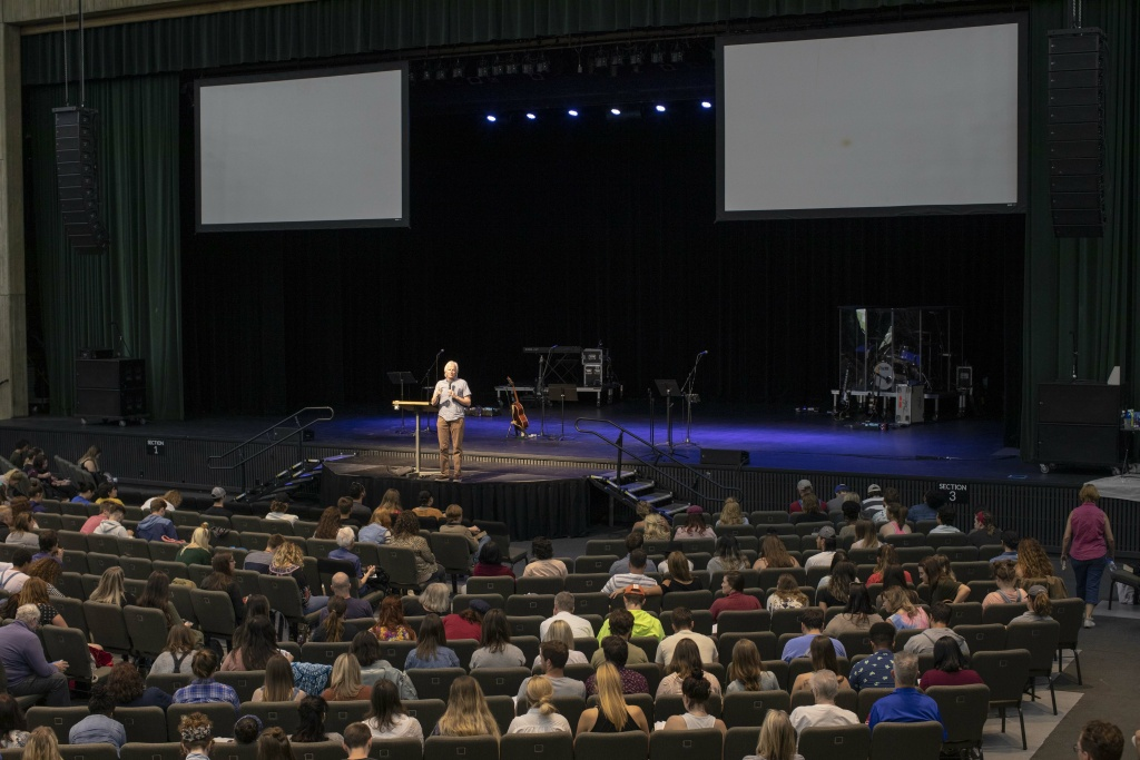 Dann Farrelly, Dean of Bethel School of Supernatural Ministry, delivers a lecture to a first-year class of about 1,200 students at the Civic Auditorium in Redding, CA, on April 29, 2019.