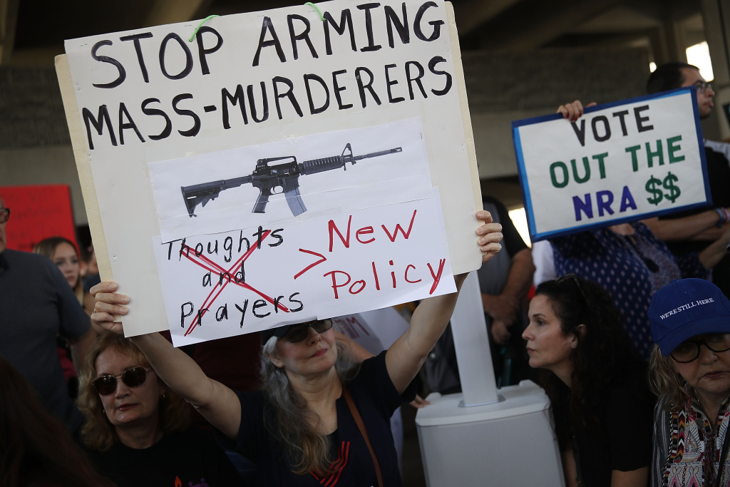 After a school shooting that killed 17, people protest guns on the steps of the Broward County Federal courthouse on February 17, 2018 in Fort Lauderdale, Florida.
