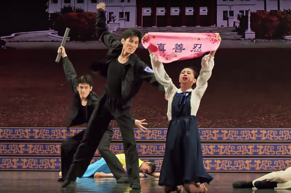 In this scene from a Shen Yun show, performers depict Communist thugs attacking Falun Gong followers.