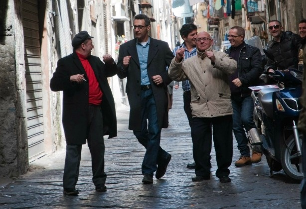 In Passione, Director John Turturro gets in front of the camera to dance with a few of the Neapolitans he meets on the street.