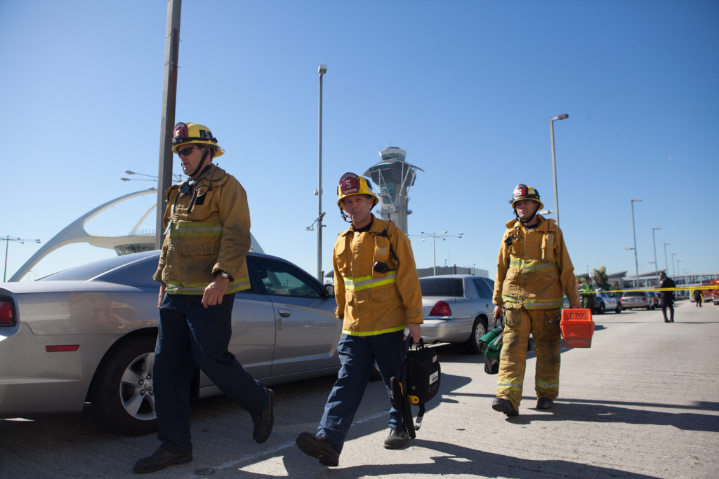 Firefighters leave the scene at LAX on November 1st, 2013.