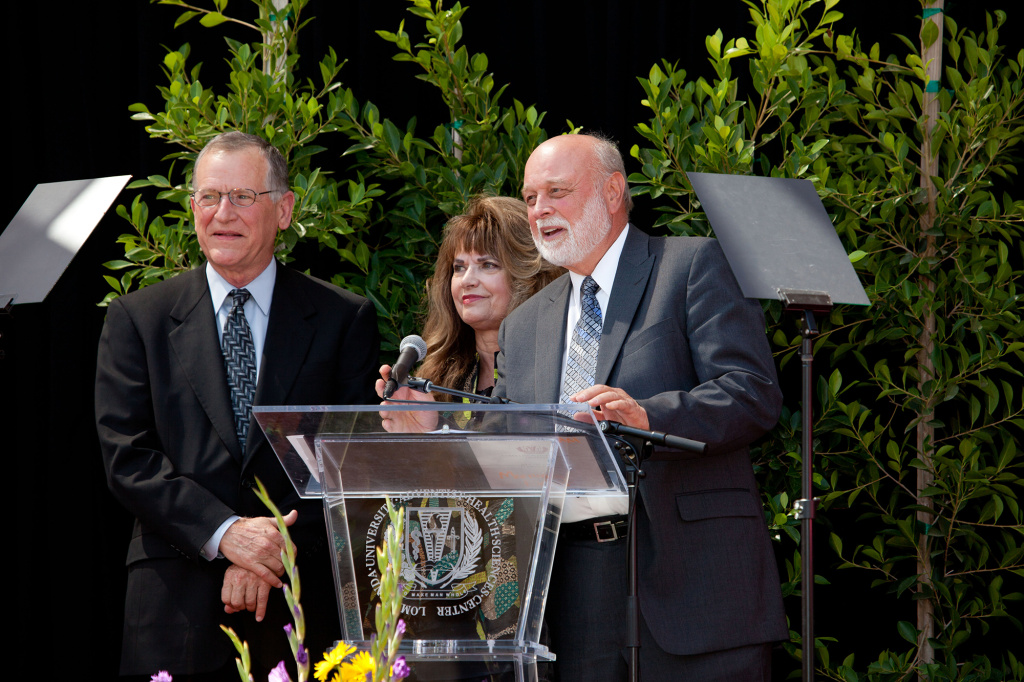 Dennis and Carol Troesh (left and center) of Riverside with Dr. Richard Hart (right), president of Loma Linda University Health, announce a $100 million gift from the couple to Loma Linda University Medical Center's $1.2 billion fundraising effort.