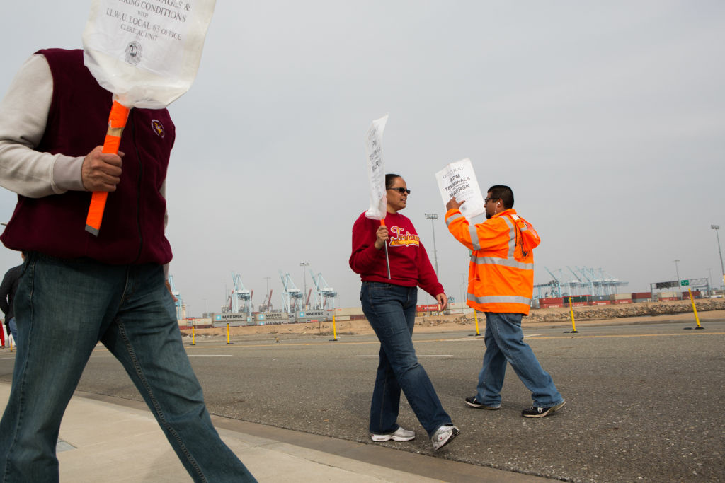 Port workers protest outside of the APM terminal on December 4th, 2012 at the Port of Los Angeles.  The clerical workers claim terminal operators are outsourcing their well-paid jobs – a claim that shippers deny.