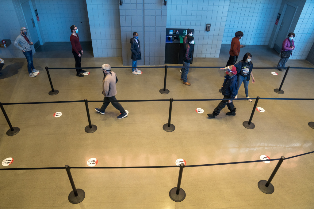 Early voters stand in line at the State Farm Arena on December 14, 2020 in Atlanta, Georgia.