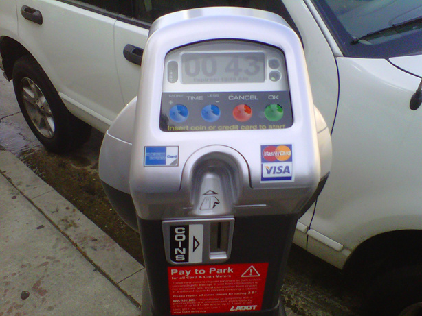 A modern parking meter that accepts credit cards.