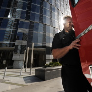A Los Angeles Fire Department inspector leaves the MGM Tower (L) in Century City after a woman was trapped in an elevator when a 7.2-magnitude earthquake hit the US-Mexico border region, on April 4, 2010.