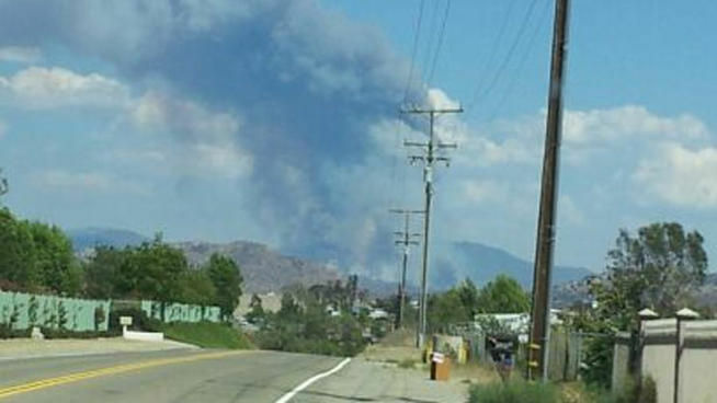 Clouds from a brush fire east of Temecula is seen on Tuesday.