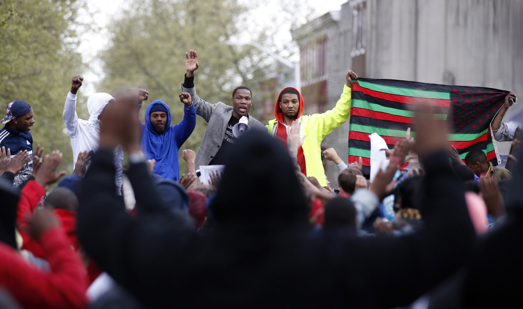 Marchers gather at the Baltimore Police Department's Western District police station during a march for Freddie Gray on Wednesday in Baltimore.