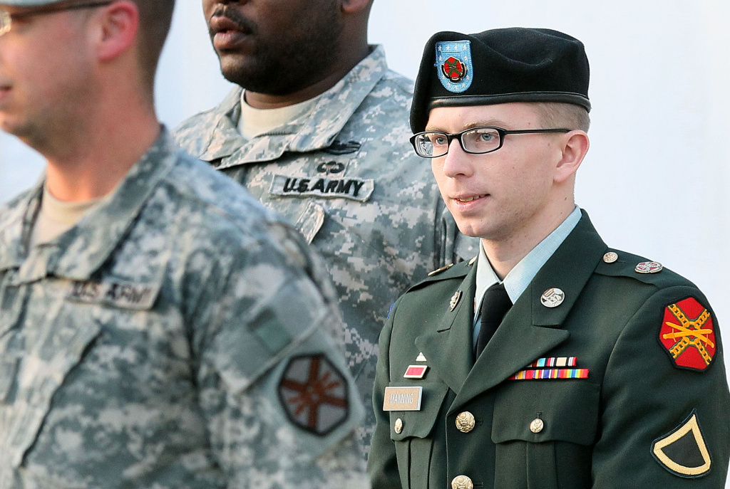 Army Private Bradley Manning is escorted away from his Article 32 hearing February 23, 2012 in Fort Meade, Maryland.