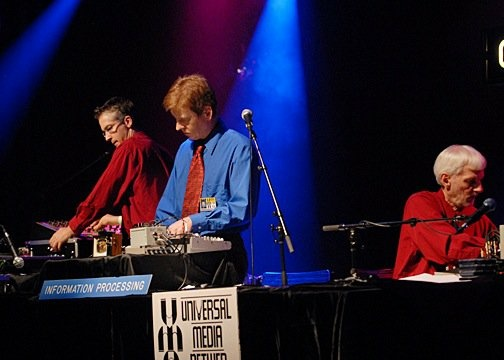 Negativland performing on stage.