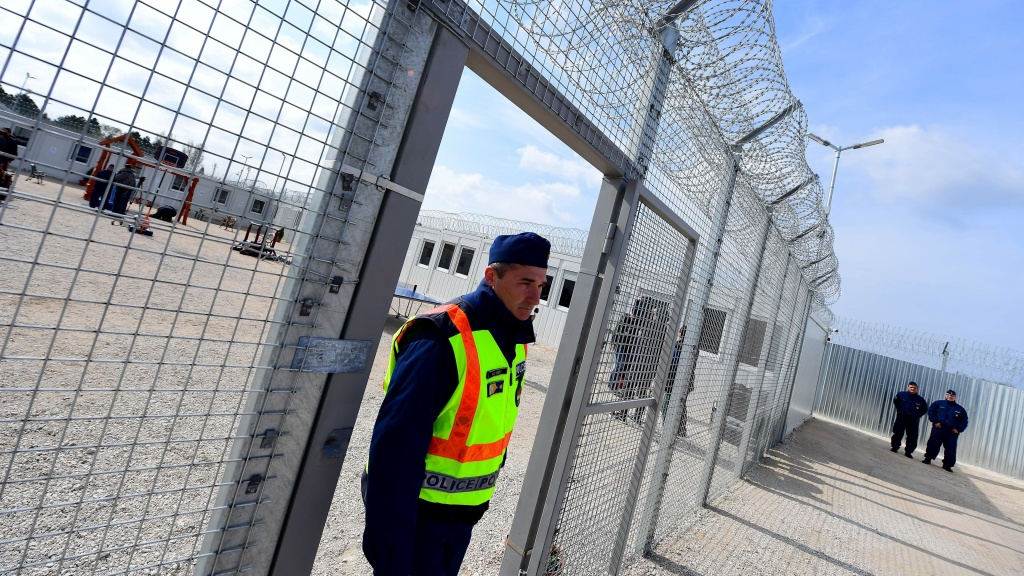 A police officer walks through a gate at the Tompa border station transit zone in April 2017. Hungary has two