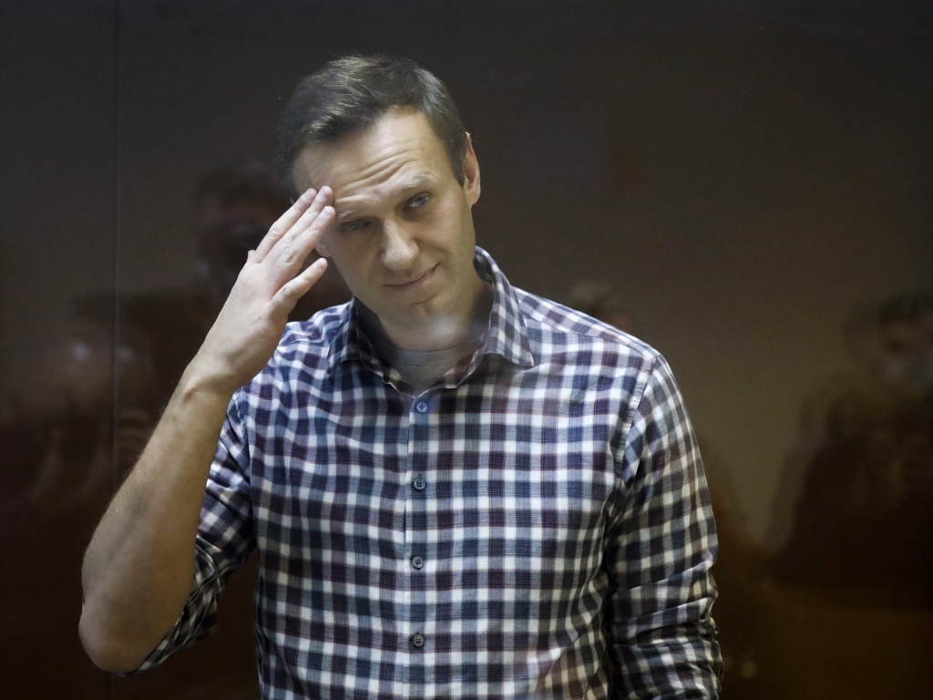 Russian opposition leader Alexei Navalny, shown here in a February court session, said he is ending his hunger strike.