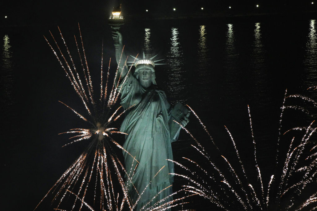 Fireworks explode around the Statue of Liberty.