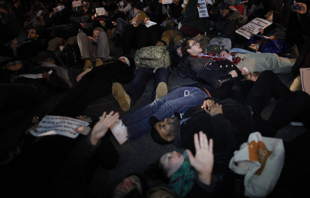 NEW YORK, NY - DECEMBER 3: People lie down in the street as they take part during a protest in support of Eric Garner at the Columbus Circle on December 3, 2014 in New York City. Garner died after being put in a chokehold during an alteration with NYPD officers in the Staten Island borough of New York City.